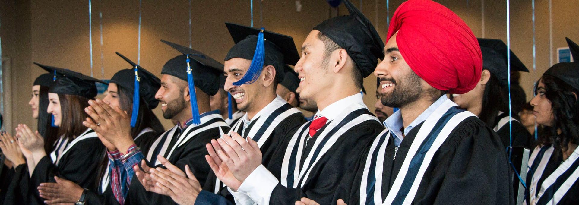 Students Celebrating Graduation, Alexander College