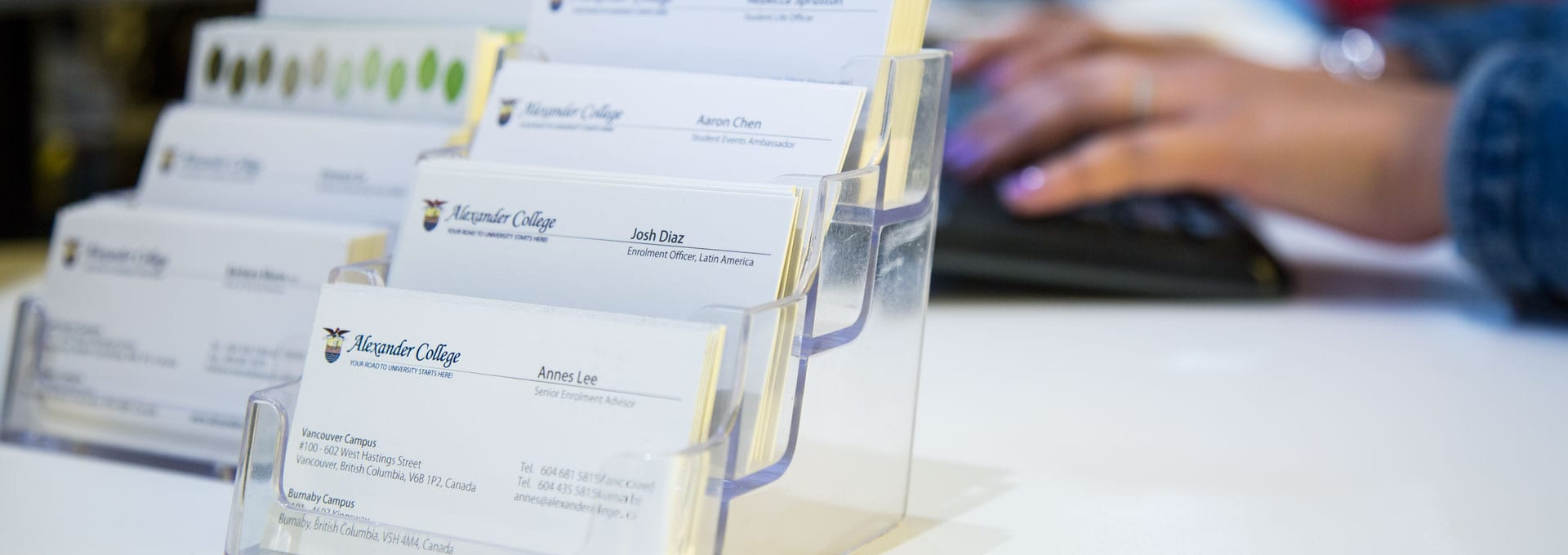 Business Cards of Alexander College Staff