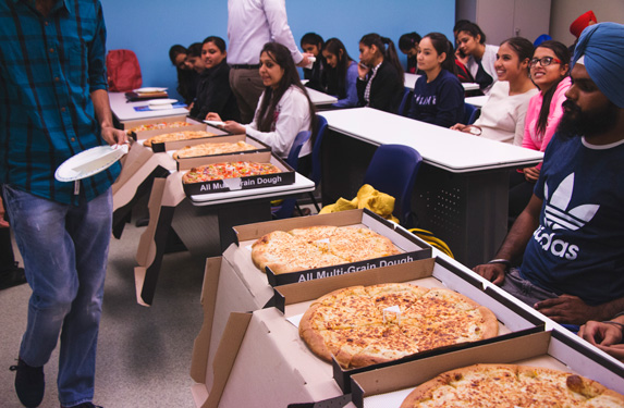 boxes of pizza inside the classroom