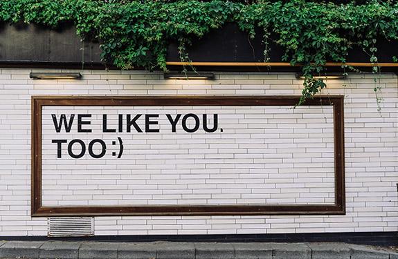 Street art displaying 'We Like You Too'