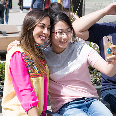 Students taking selfies and making friends