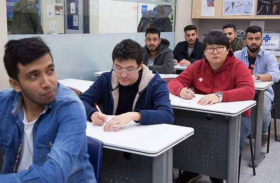 Students Inside the Classroom Listening to Instructor