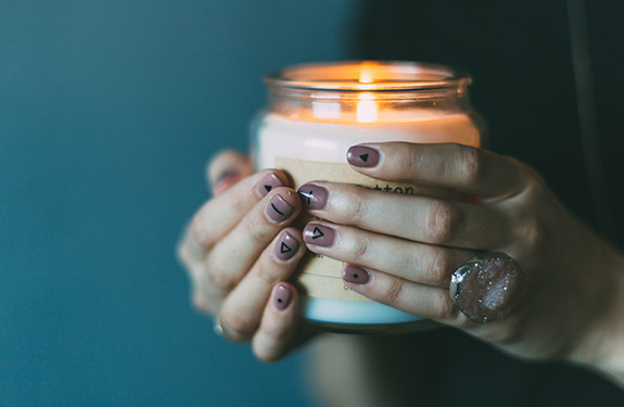Girl holding calming candle