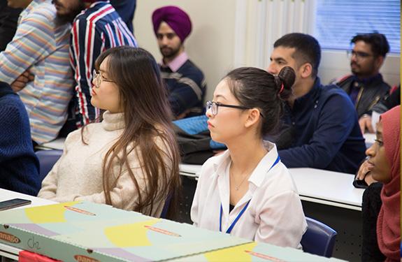 Students focus on a presentation