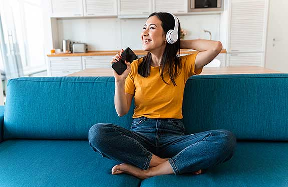 happy girl listening to music on phone