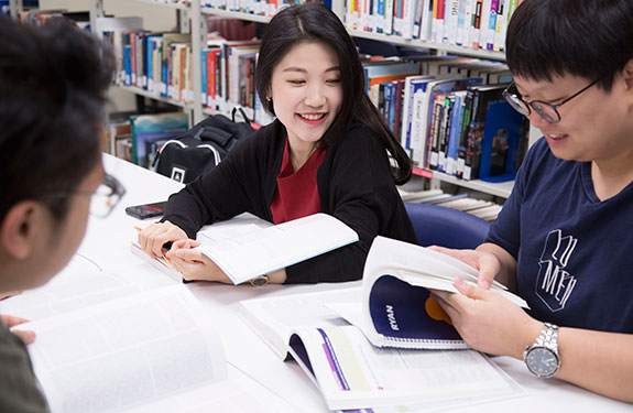 Alexander College Students Inside the Library