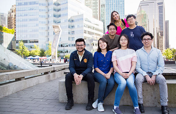 group of international students in vancouver smiling at the camera