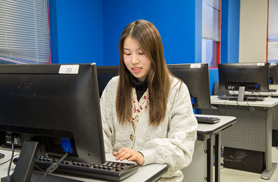 Student Using Computer at Alexander College