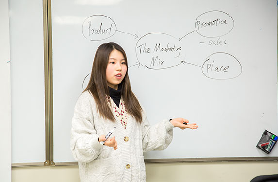 Student Teaching about Marketing at Alexander College