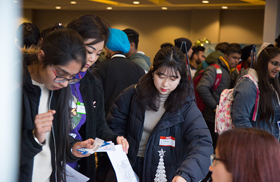 Students checking program during orientation