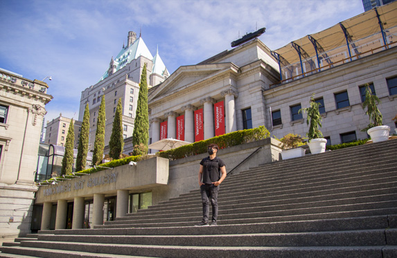 person standing outside the vancouver art gallery