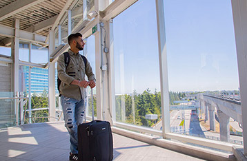 Alexander College international student at the airport