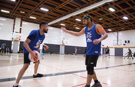 international students at alexander college playing basketball