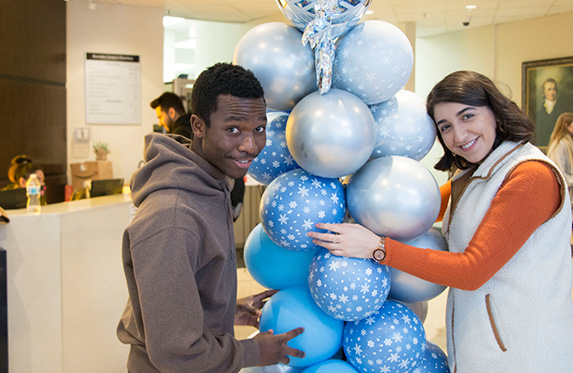 international students smiling at the camera