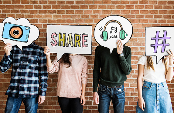 Friends holding up thought bubbles with social media concept icon